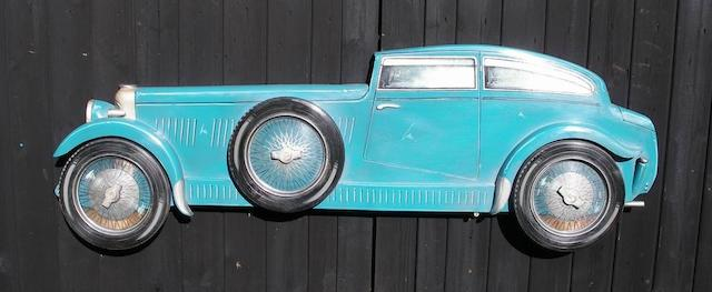 A hand-painted wooden profile of an 'Art Deco' styled Bentley Speed Six,
