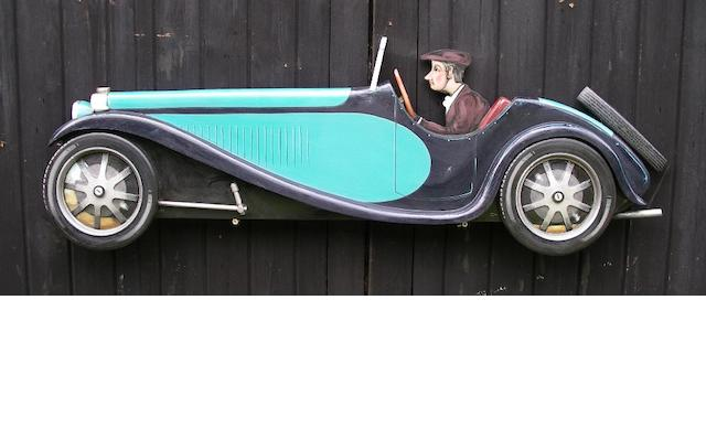 A hand-painted wooden profile of a Type 55 Bugatti,