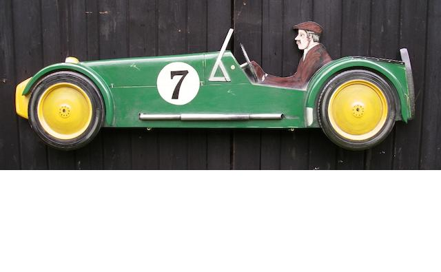 A hand-painted wooden profile of a Lotus 7,