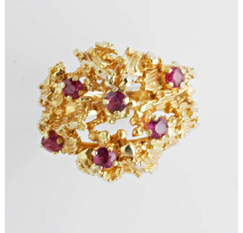 A ruby ring of abstract design, (5)