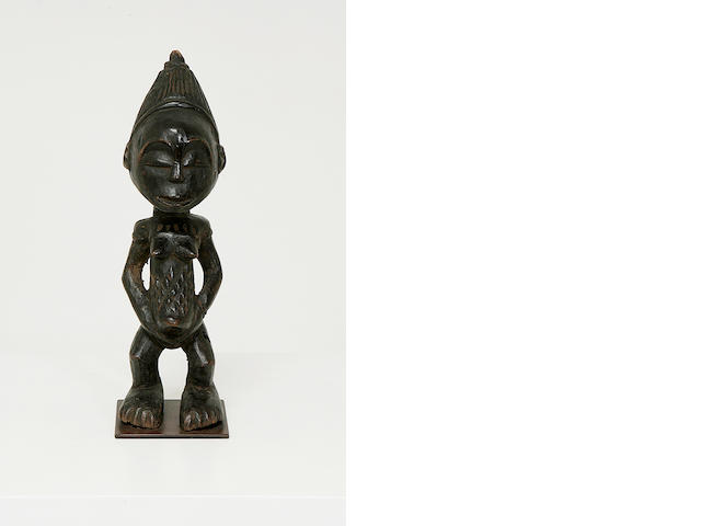 A wood tribal figure,
