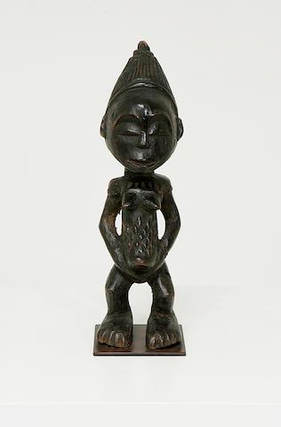 A wood tribal figure,