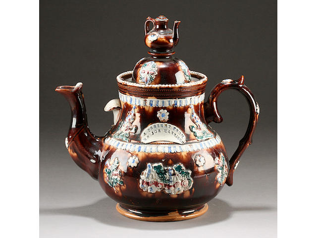 A large Measham or bargeware teapot and cover