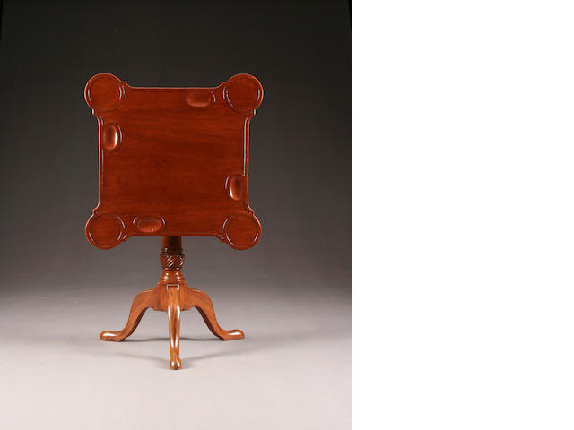 A George III mahogany tilt top tripod games table