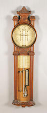 A Fitzroy style barometer, the circular dial in carved oak case over glazed trunk with thermometer and weather glass.