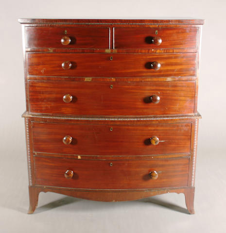 An early 19th century mahogany bow front chest-on-chest