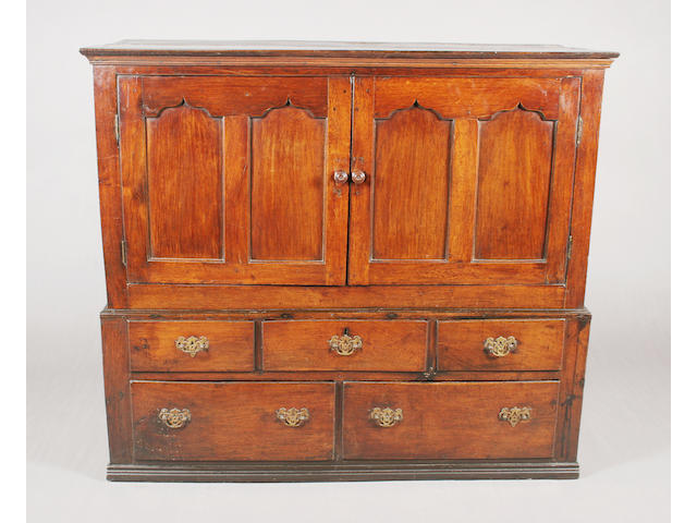 A mid-18th century Welsh oak press cupboard of low proportions
