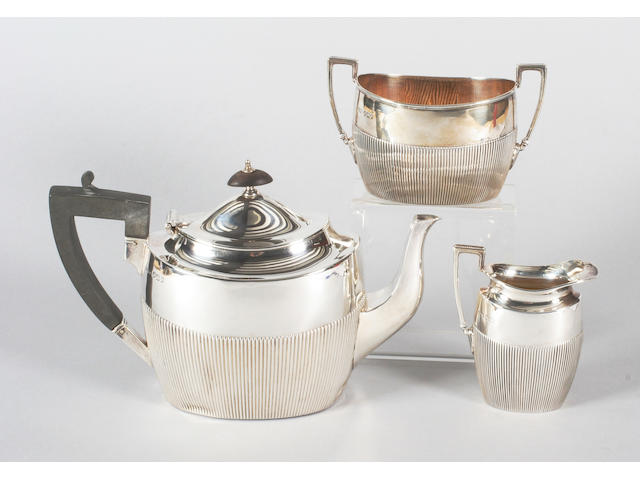 A late Victorian silver three piece tea set By J Dixon and Sons, Sheffield, 1899,  (3)