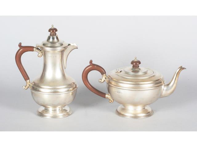 A silver teapot and matching hot water pot Birmingham, 1933,