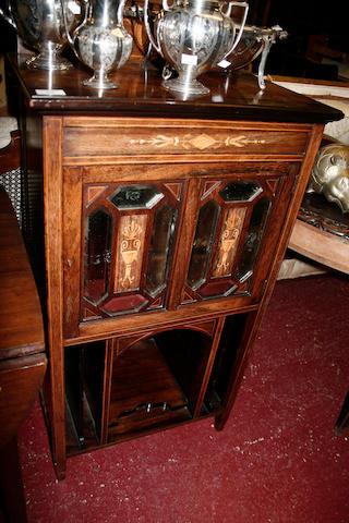 An Edwardian  rosewood music cabinet