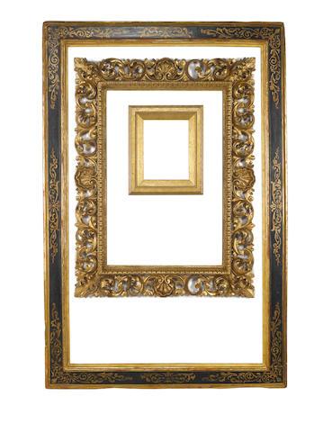 An Italian 17th Century parcel gilt and black painted cassetta frame
