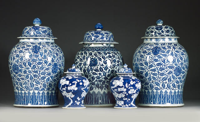 A set of three Chinese porcelain blue and white vases and covers