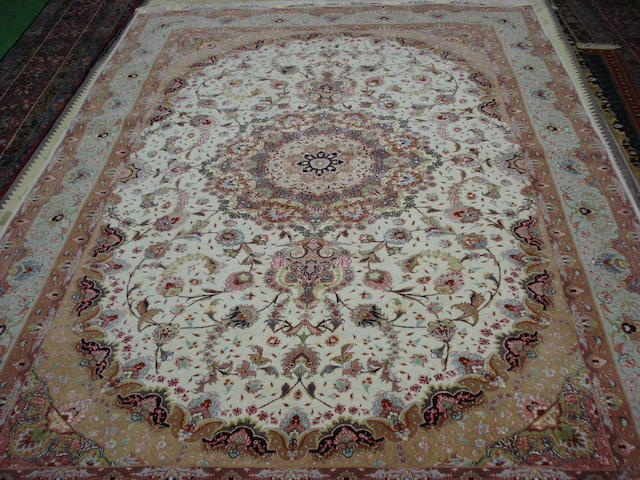 A part silk Tabriz carpet North West Persia, 300cm x 200cm