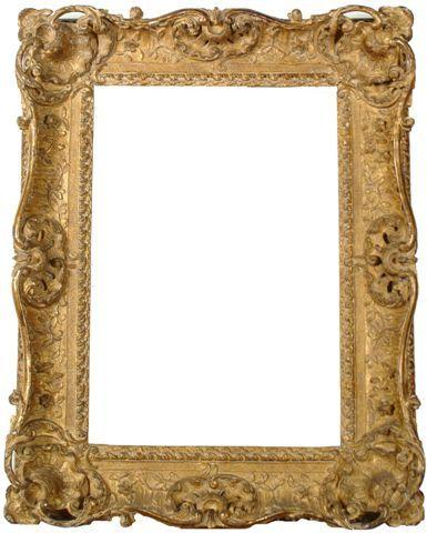 A Louis XIV style carved frame