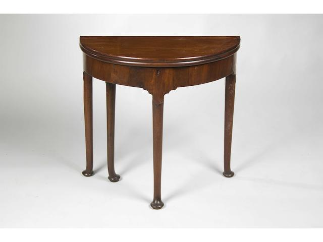 A George II mahogany demi-lune tea table