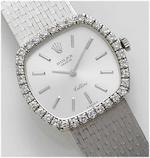 Rolex. A lady's 18ct white gold diamond set bracelet watch Cellini, 1970's