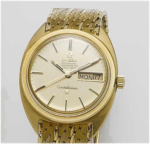 Omega. An 18ct gold centre seconds calendar bracelet watch Constellation, 1970's
