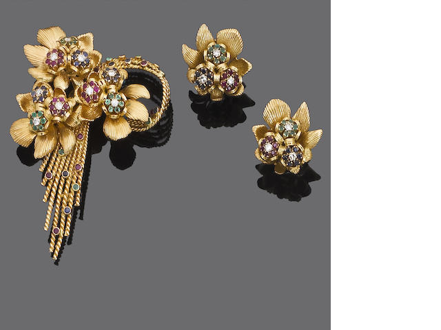 A gold and gem-set brooch and earclip suite, by Kutchinsky,