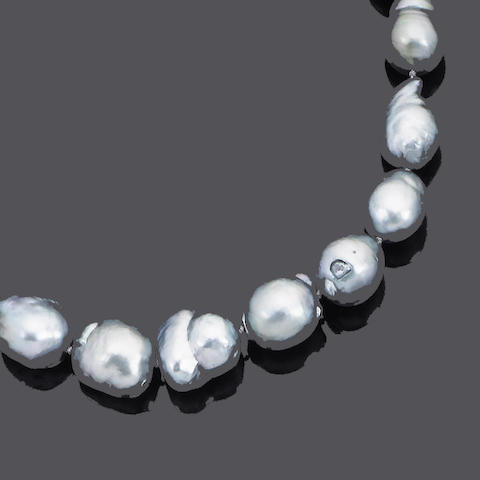 A baroque cultured pearl necklace, ring and earring suite (3) (partially illustrated)