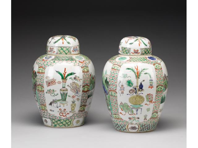 A matched pair of famille verte oviform vases;