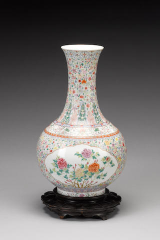 A famille rose bottle vase decorated with a 'mille-fleurs' ground;