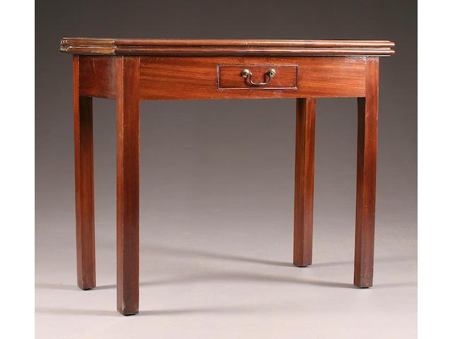 A mahogany fold-over tea table, 19th Century