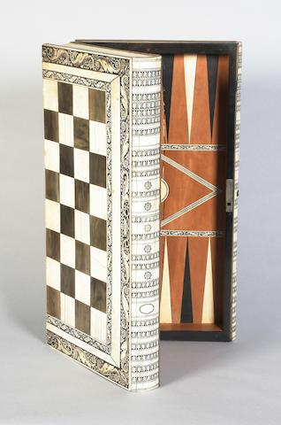 An early 19th century ivory, sandalwood, ebony and horn chess board/games box, Vizagaptam, circa 1820
