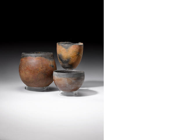 Three Egyptian Predynastic red and black ware vessels (3)