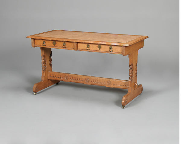 A mid Victorian carved oak writing tableby Crace and Sons, the design probably by A.W.N Pugin