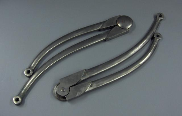 A pair of pram-iron hood supports,