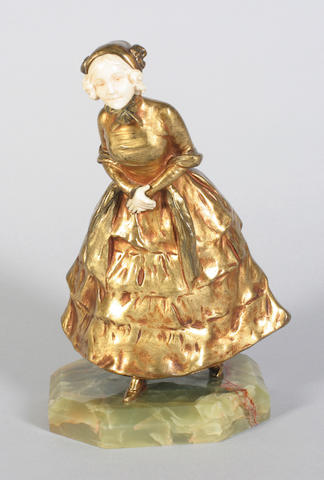 An early 20th century Goldscheider gilt bronze and carved ivory mounted figure