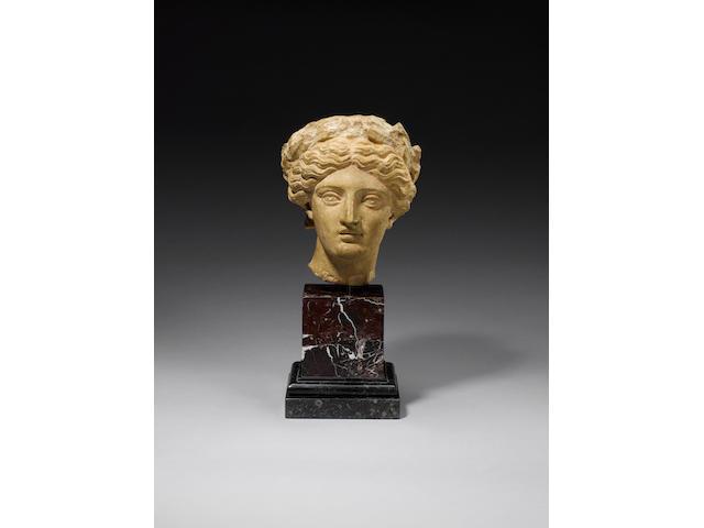 A Roman limestone head of Apollo