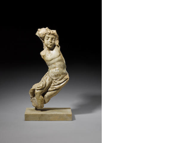A Roman marble relief fragment of a faun