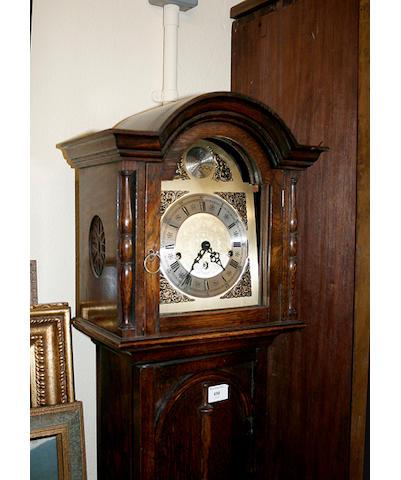 A dwarf longcase clock