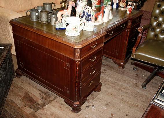 A reproduction mahogany twin pedestal partners desk,