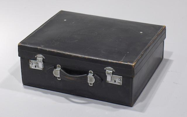 A leather motoring suitcase, by S Reid, London,