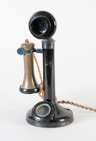 An upright desk candlestick telephone