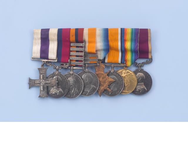A Boar war/WW1 medal group, miniatures, a silver cup for shooting, three photos, housed within a wal