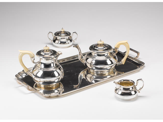 A four piece silver tea service and tray, maker's mark RWB, London 1935/6, also incuse stamped Harrods London,  (6)