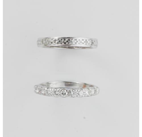 A diamond half eternity ring and a diamond full eternity ring, (2)