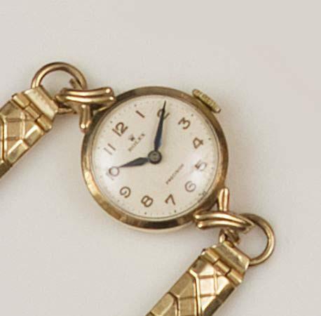 Rolex: A lady's 9ct gold wristwatch,
