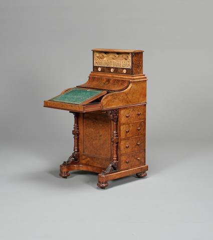 A mid Victorian burr walnut piano top davenport