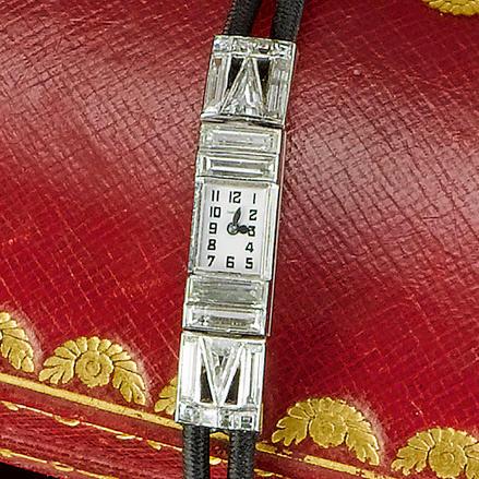 An art deco diamond and enamel wristwatch, by Cartier,