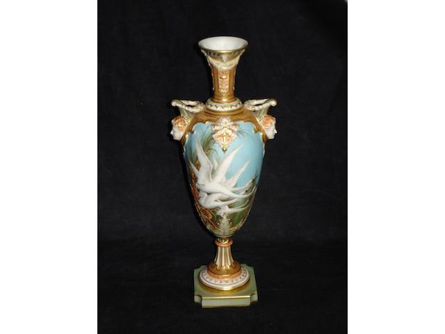A Royal Worcester pedestal vase by Charley Baldwyn, dated 1903