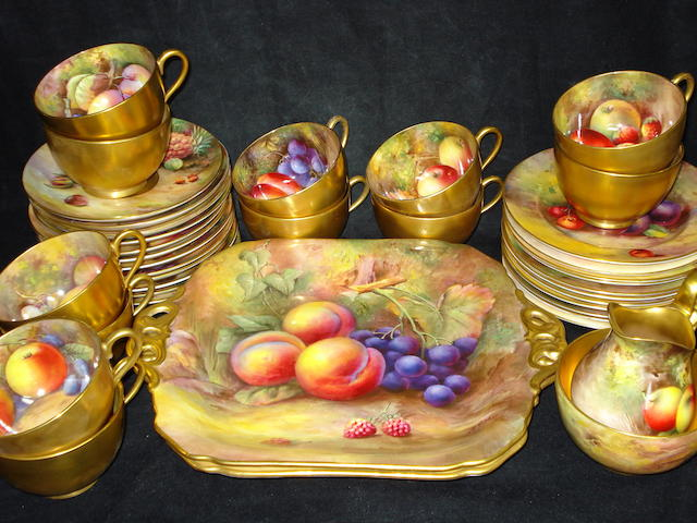 A Royal Worcester fruit painted tea set, dated 1933