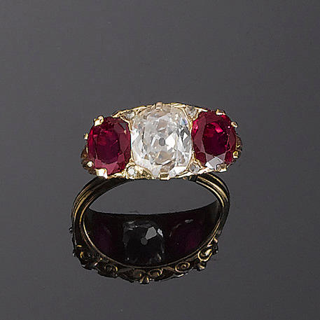 A late 19th century ruby and diamond three-stone ring,