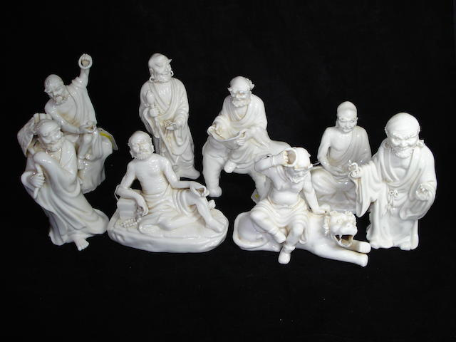 A set of eight slip-moulded Lohan figures, 20th Century