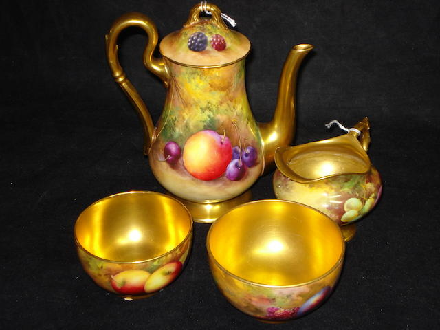 A Royal Worcester four piece fruit painted coffee set