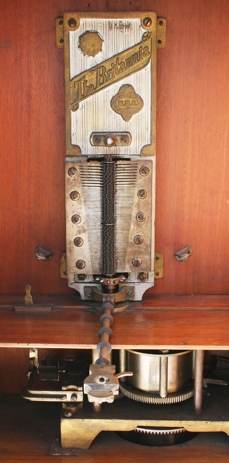 A coin-in-the-slot operated Britannia upright disc musical box made by B H Abrahams
