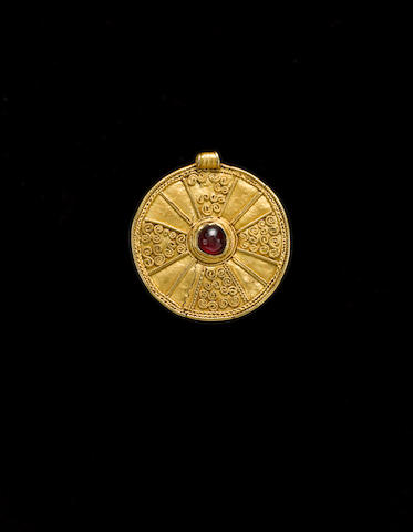 An Anglo-Saxon gold and garnet pendant